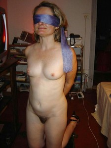 Blindfolded mature..