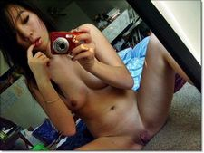 Asian chick nude selfie.